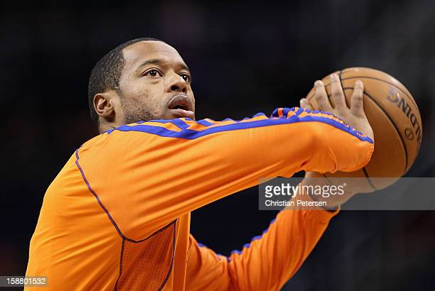 Marcus Camby of the New York Knicks warms up before the NBA game against the Phoenix Suns at US Airways Center on December 26 2012 in Phoenix Arizona...