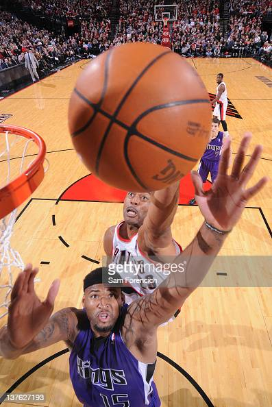 Marcus Camby of the Portland Trail Blazers takes a jump shot over DeMarcus Cousins of the Sacramento Kings during the game on January 23 2012 at the...
