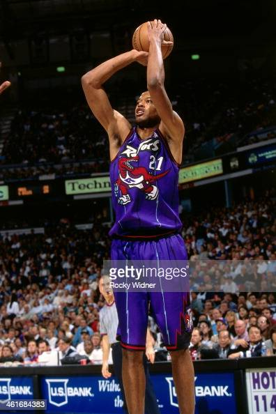 Marcus Camby of the Toronto Raptors shoots the ball during a game played on March 3 1997 at Arco Arena in Sacramento California NOTE TO USER User...