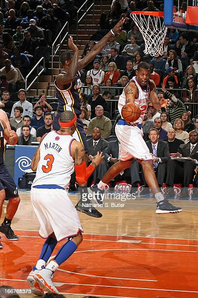 Marcus Camby passes the ball to teammate Kenyon Martin of the New York Knicks during the game against the Utah Jazz on March 9 2013 at Madison Square...