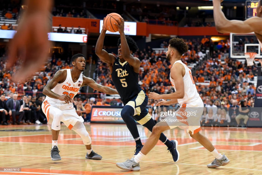 Marcus Carr #5 of the Pittsburgh Panthers drives between Frank Howard #23 and Oshae Brissett #11 of the Syracuse Orange during the first half of play between the Syracuse Orange and the Pittsburgh Panthers on January 16th, 2018 at the Carrier Dome in Syracuse, NY.