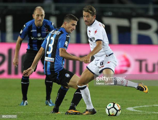 Marcus Christer Rohden of FC Crotone competes for the ball with Mattia Caldara of Atalanta BC during the Serie A match between Atalanta BC and FC...