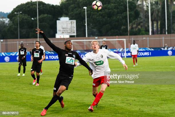 Marcus Coco of Guingamp and Damien Tiberi of Frejus during the French National Cup Quarter Final match between Frejus Saint Raphael and En Avant...