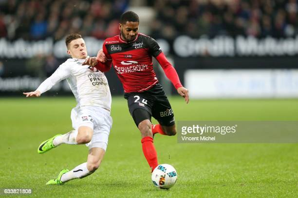 Marcus Coco of Guingamp and Frederic Guilbert of Caen during the Ligue 1 match between EA Guingamp and SM Caen at Stade du Roudourou on February 4...