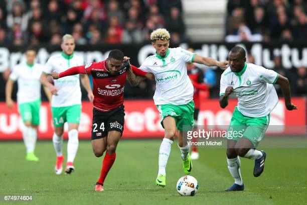 Marcus Coco of Guingamp and Kevin Malcuit and Kevin TheophileCatherine of SaintEtienne during the French Ligue 1 match between Guingamp and Saint...