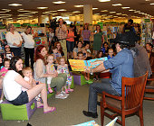 Marcus Collins John Hagen and JC Fisher of The Texas Tenors Sign Copies Of Their Book 'Ruckus On The Ranch' at Barnes Noble Princeton on June 16 2015...