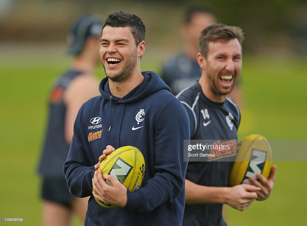 Marcus Davies and <a gi-track='captionPersonalityLinkClicked' href=/galleries/search?phrase=Brock+McLean&family=editorial&specificpeople=239175 ng-click='$event.stopPropagation()'>Brock McLean</a> laugh during a Carlton Blues AFL Recovery Session at St Kilda Sea Baths on July 15, 2013 in Melbourne, Australia.