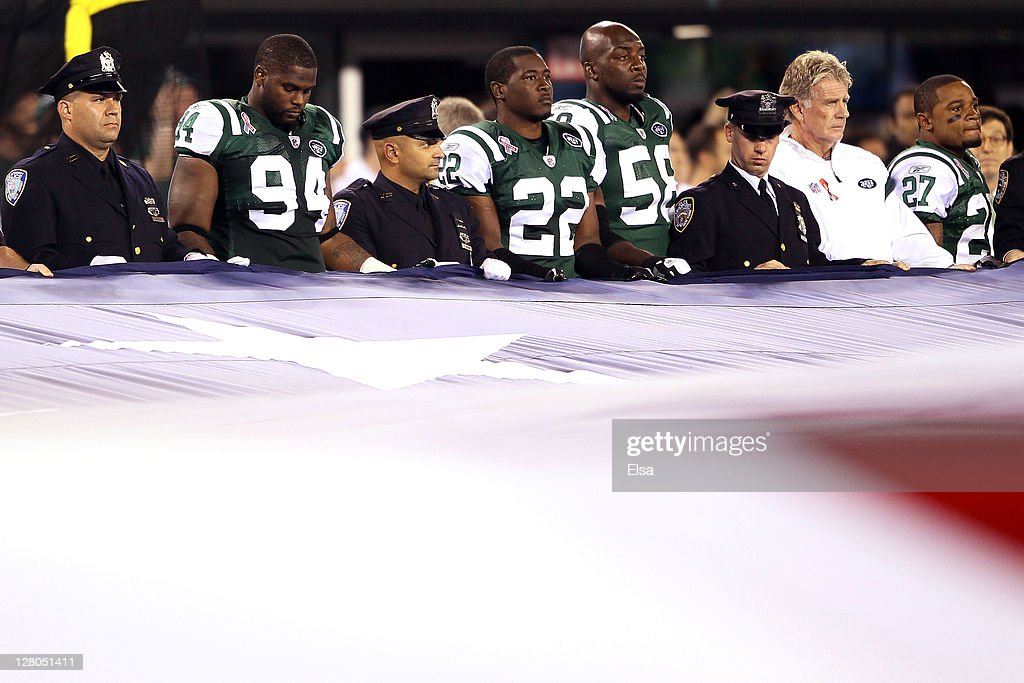 Marcus Dixon Brodney Pool Bryan Thomas and special teams coach Mike Westhoff of the New York Jets stand with 9/11 first responders as the hold an...
