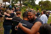 Marcus Ealy gets a hug from Joshua Soto before a vigil and church service held at Joy Meropolitan Community Church very close to Pulse nightclub...