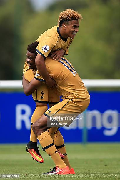 Marcus Edwards of Tottenham celebrates with team mates after scoring his teams first goal of the game during the Premier League 2 match between...