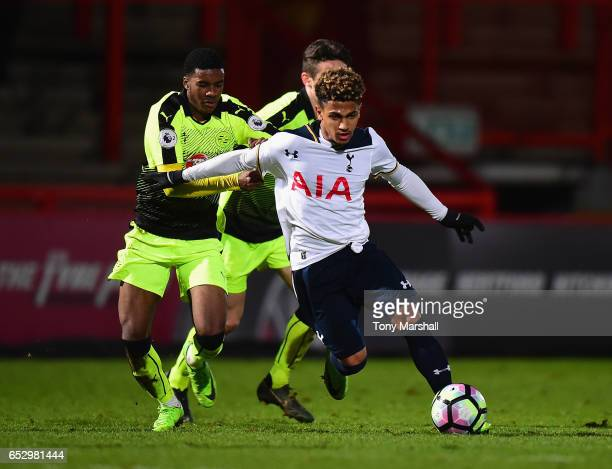 Marcus Edwards of Tottenham Hotspur is tackled by Ramarni MedfordSmith of Reading during the Premier League 2 match between Tottenham Hotspur and...
