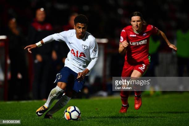 Marcus Edwards of Tottenham Hotspur makes a break past Aaron Lewis of Swansea City during the Premier League 2 match between Tottenham Hotspur and...
