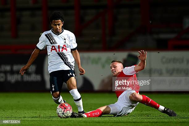 Marcus Edwards of Tottenham Hotspur rides the tackle of Fabian Bailey of Rotherham United during the FA Youth Cup match between Tottenham Hotspur and...