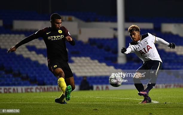 Marcus Edwards of Tottenham Hotspur takes a shot at goal under pressure from Cameron Humphreys of Manchester City during the Premier League 2 match...