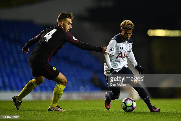 Marcus Edwards of Tottenham Hotspur takes on Charlie Oliver of Manchester City during the Premier League 2 match between Tottenham Hotspur and...