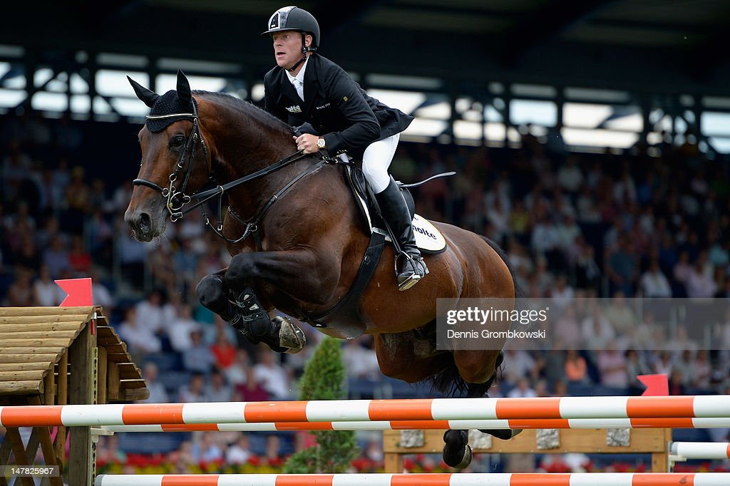 Marcus Ehning of Germany and Copin van de Broy compete in the Warsteiner Price of Europe S4 jumping competition during day two of the 2012 CHIO...
