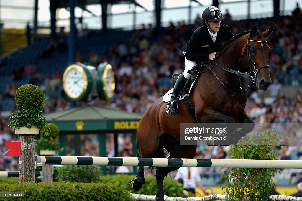 Marcus Ehning of Germany and his horse Copin van de Broy compete in the RWE Prize of NorthRhineWestphalia jumping competition during day four of the...