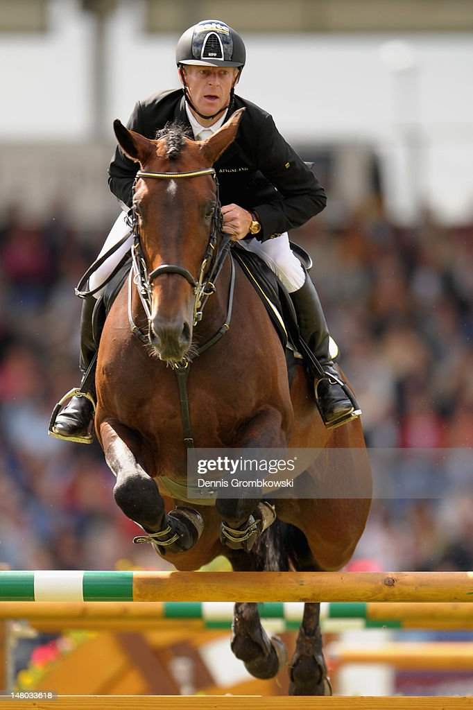 Marcus Ehning of Germany and his horse Copin van de Broy compete in the Rolex Grand Prix jumping competition during day six of the 2012 CHIO Aachen...