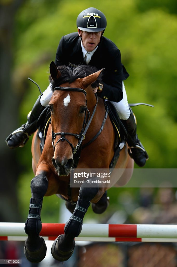 Marcus Ehning of Germany and Noltes Kuechengirl compete in the CSI5 jumping competition against the clock during day two of the German Jumping...