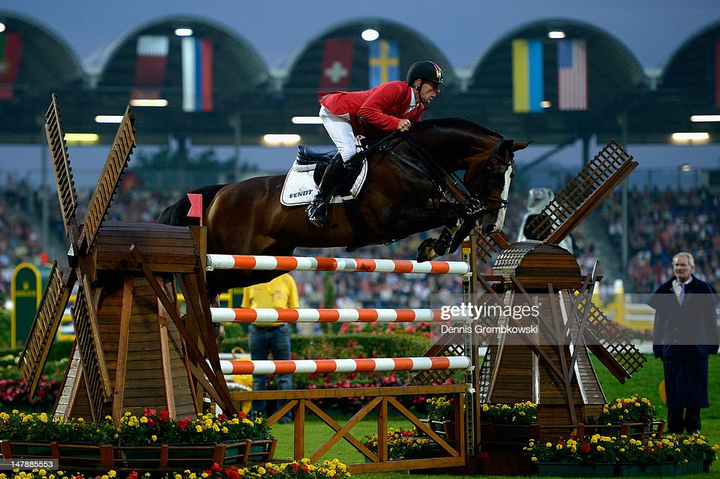 Marcus Ehning of Germany and Plot Blue 2 compete in the MercedesBenz Price team jumping competition during day three of the 2012 CHIO Aachen...