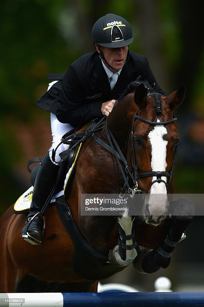 Marcus Ehning of Germany and Plot Blue compete in the CSI5 Global Champions Tour Grand Prix of Hamburg during day three of the German Jumping...