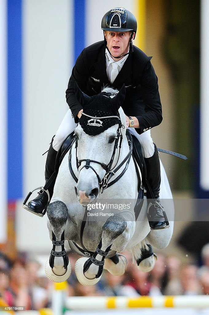 <a gi-track='captionPersonalityLinkClicked' href=/galleries/search?phrase=Marcus+Ehning&family=editorial&specificpeople=539689 ng-click='$event.stopPropagation()'>Marcus Ehning</a> of Germany on Cornado NRW in action to win the Grand Prix Hermes during the third day of the Grand Prix Hermes of Paris at Grand Palais on March 16, 2014 in Paris, France.