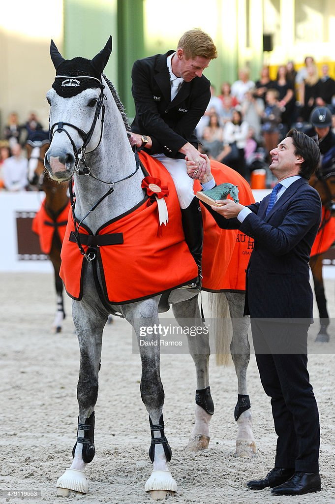 Marcus Ehning of Germany on Cornado NRW recevies the trophy from the Hermes CEO Axel Dumas after winning the Grand Prix Hermes during the third day...