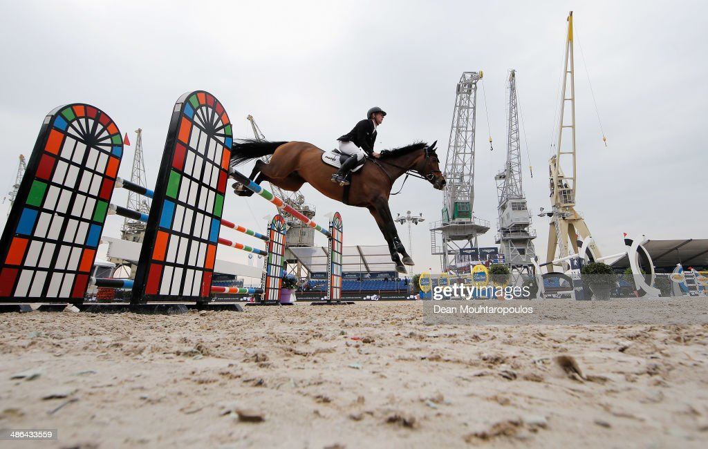 <a gi-track='captionPersonalityLinkClicked' href=/galleries/search?phrase=Marcus+Ehning&family=editorial&specificpeople=539689 ng-click='$event.stopPropagation()'>Marcus Ehning</a> of Germany on Sabrina competes in the CSI5* 2 Phases Special during day one of the Longines Global Champions Tour of Antwerp at the Waagnatie on April 24, 2014 in Antwerpen, Belgium.