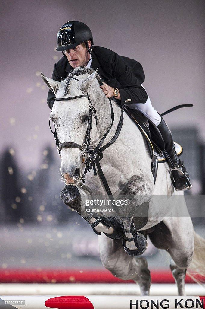 Marcus Ehning of Germany rides Cornado NRW at the Gucci Gold CUp during the Longines Hong Kong Masters International Show Jumping at Asia World Expo on March 1, 2013 in Hong Kong, Hong Kong.