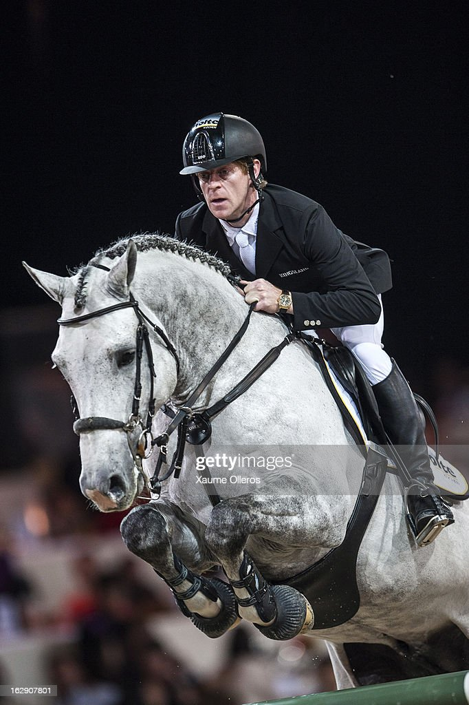 Marcus Ehning of Germany rides Cornado NRW at the Gucci Gold CUp during the Longines Hong Kong Masters International Show Jumping at Asia World Expo...