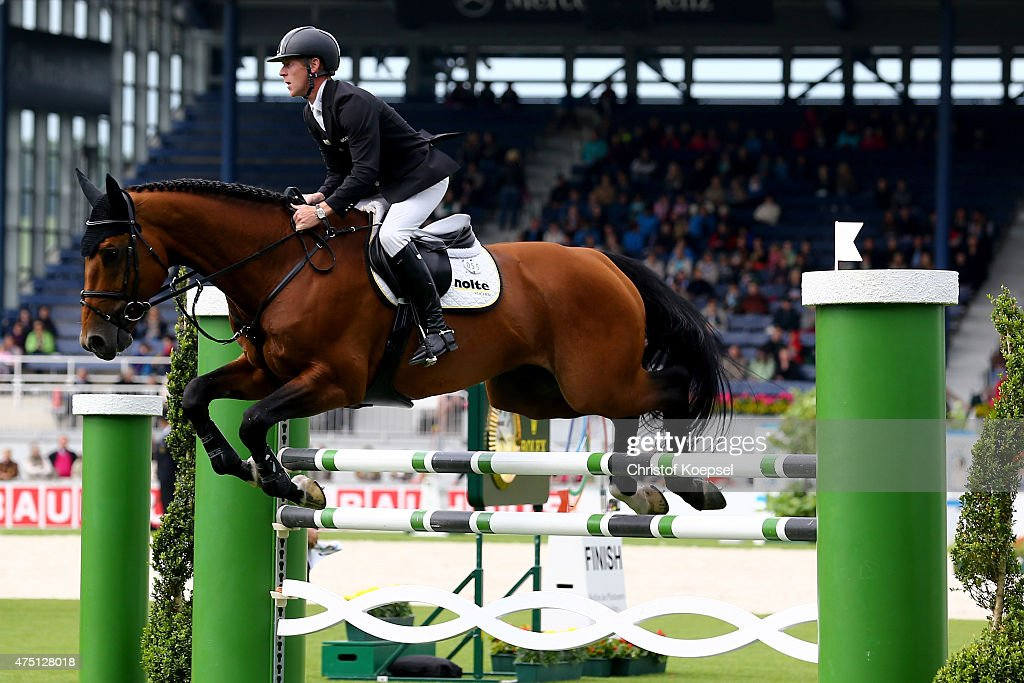 Marcus Ehning of Germany rides on Cannonball Du Toultia Z of the SparkassenYoungstersCup competition during the 2015 CHIO Aachen tournament at...