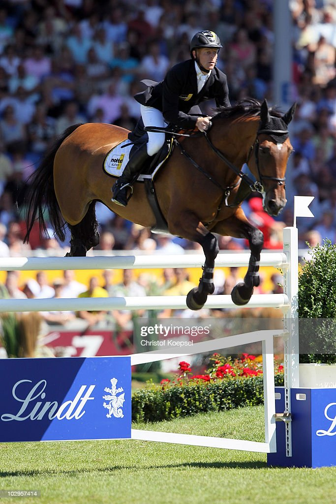 Marcus Ehning of Germany rides on Noltes Kuechengirl during the Rolex Grand Prix Jumping competition of the CHIO on July 18 2010 in Aachen Germany