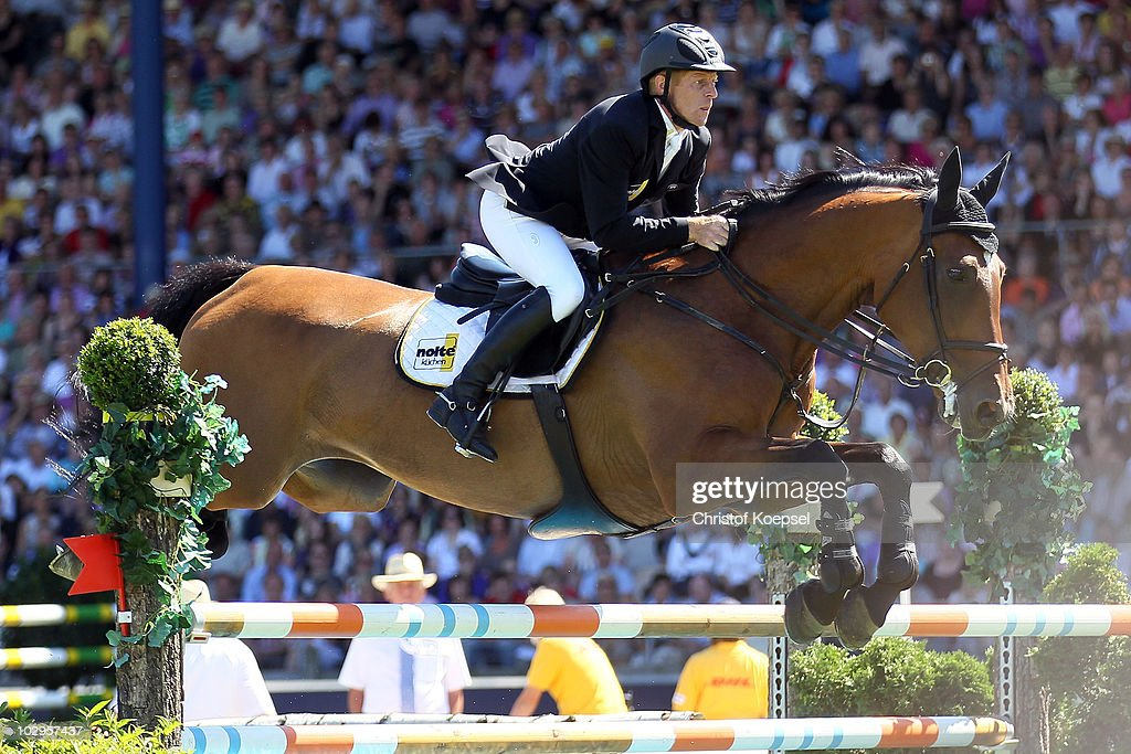 <a gi-track='captionPersonalityLinkClicked' href=/galleries/search?phrase=Marcus+Ehning&family=editorial&specificpeople=539689 ng-click='$event.stopPropagation()'>Marcus Ehning</a> of Germany rides on Noltes Kuechengirl during the Rolex Grand Prix Jumping competition of the CHIO on July 18, 2010 in Aachen, Germany.