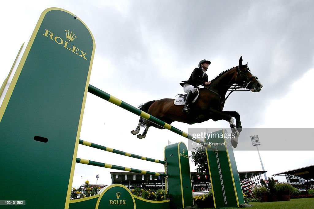 Marcus Ehning of Germany rides on Plot Blue and won the third place of the Rolex Grand Prix jumping competition during the 2014 CHIO Aachen...