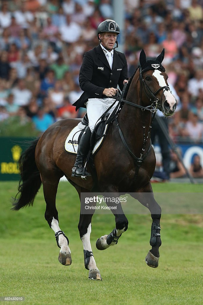 <a gi-track='captionPersonalityLinkClicked' href=/galleries/search?phrase=Marcus+Ehning&family=editorial&specificpeople=539689 ng-click='$event.stopPropagation()'>Marcus Ehning</a> of Germany rides on Plot Blue and won the third place of the Rolex Grand Prix jumping competition during the 2014 CHIO Aachen tournament on July 20, 2014 in Aachen, Germany.