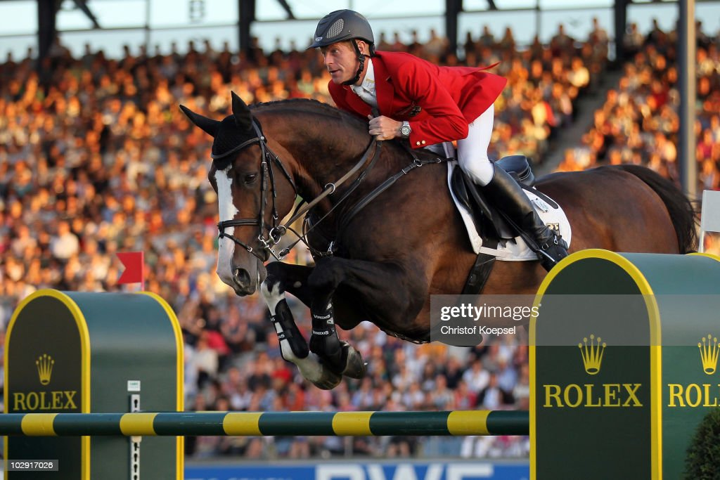 <a gi-track='captionPersonalityLinkClicked' href=/galleries/search?phrase=Marcus+Ehning&family=editorial&specificpeople=539689 ng-click='$event.stopPropagation()'>Marcus Ehning</a> of Germany rides on Plot Blue during the Mercedes-Benz Prize as part of the Meydan FEI Nations Cup of the CHIO on July 15, 2010 in Aachen, Germany.