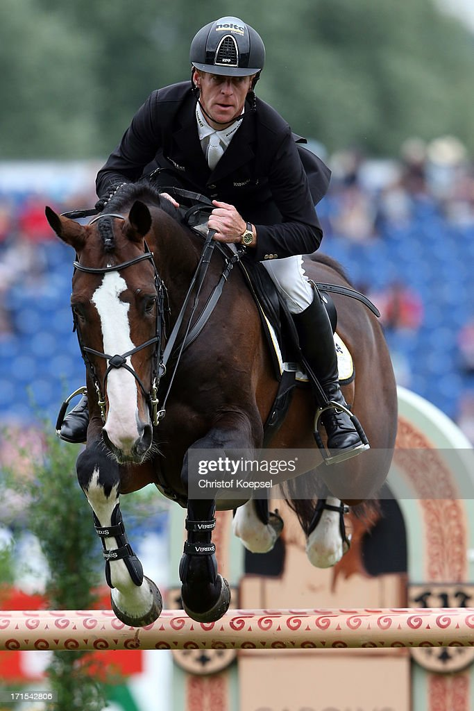 Marcus Ehning of Germany rides on Plot Blue during the Warsteiner Price jumping competition during day two of the 2013 CHIO Aachen tournament on June...
