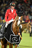 Marcus Ehning riding Pret A Tout during the ceremony for the German team after their victory in the Nations Cup on July 14 2016 in Aachen Germany