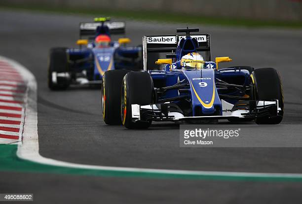 Marcus Ericsson of Sweden and Sauber F1 drives ahead of Felipe Nasr of Brazil and Sauber F1 during practice for the Formula One Grand Prix of Mexico...