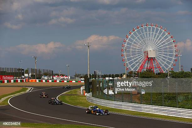 Marcus Ericsson of Sweden and Sauber F1 drives ahead of Sergio Perez of Mexico and Force India and Daniil Kvyat of Russia and Infiniti Red Bull...