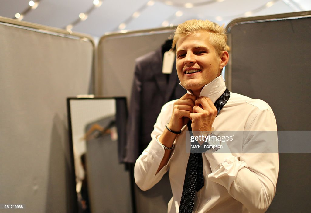 <a gi-track='captionPersonalityLinkClicked' href=/galleries/search?phrase=Marcus+Ericsson&family=editorial&specificpeople=6547855 ng-click='$event.stopPropagation()'>Marcus Ericsson</a> of Sweden and Sauber F1 gets ready backstage at the Amber Lounge fashion show during previews to the Monaco Formula One Grand Prix at Circuit de Monaco on May 27, 2016 in Monte-Carlo, Monaco.