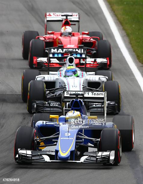 Marcus Ericsson of Sweden and Sauber F1 is pursued by Felipe Massa of Brazil and Williams and Sebastian Vettel of Germany and Ferrari during the...