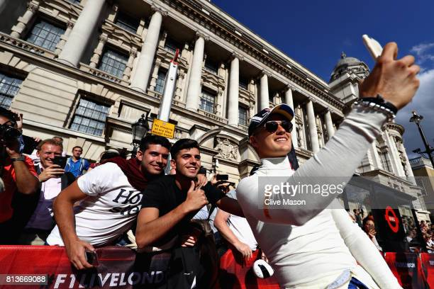 Marcus Ericsson of Sweden and Sauber F1 takes a selfie with fans during F1 Live London at Trafalgar Square on July 12 2017 in London England F1 Live...