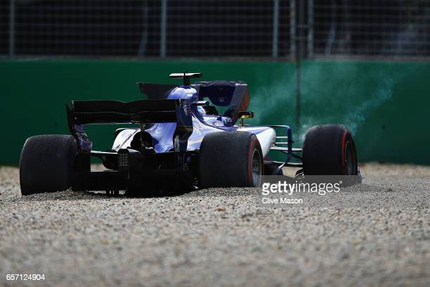 Marcus Ericsson of Sweden driving the Sauber F1 Team Sauber C36 Ferrari in the gravel trap after spinning during practice for the Australian Formula...