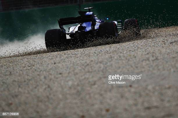 Marcus Ericsson of Sweden driving the Sauber F1 Team Sauber C36 Ferrari spins into the gravel trap during practice for the Australian Formula One...