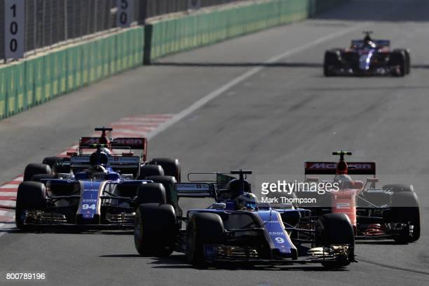 Marcus Ericsson of Sweden driving the Sauber F1 Team Sauber C36 Ferrari leads Stoffel Vandoorne of Belgium driving the McLaren Honda Formula 1 Team...