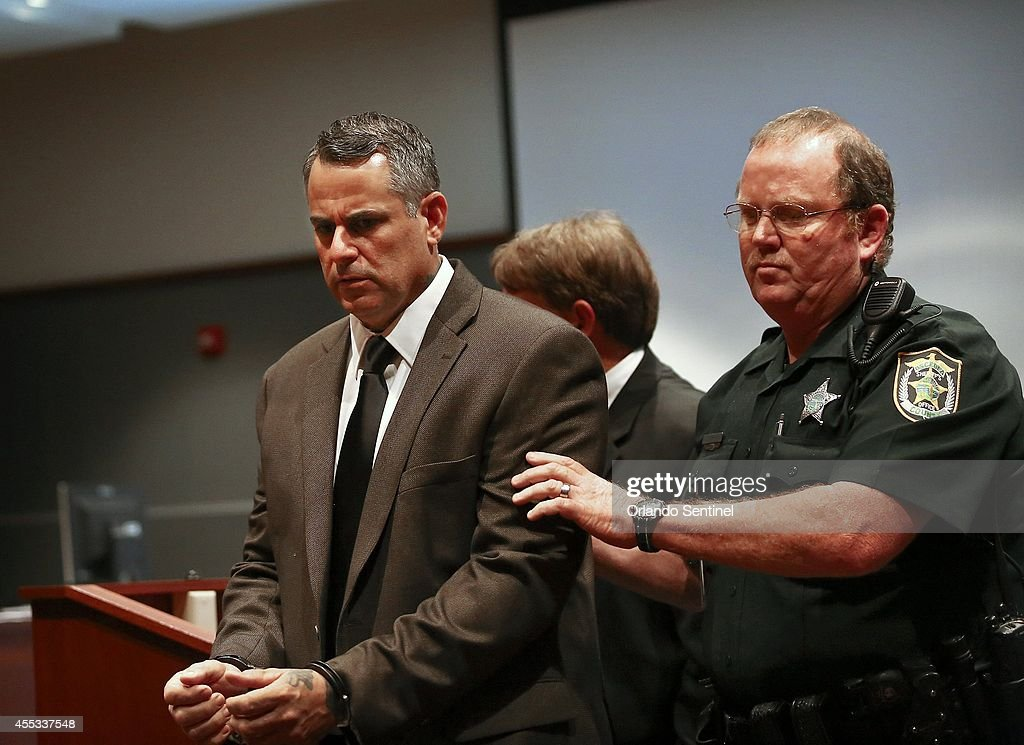 Marcus Faella is escorted out of the courtroom shortly after being found guilty on two domestic terrorism charges at the Osceola County Courthouse on...