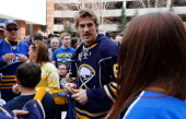 Marcus Foligno of the Buffalo Sabres and teammates greet fans before their game against the New York Islanders on April 13 2014 at the First Niagara...