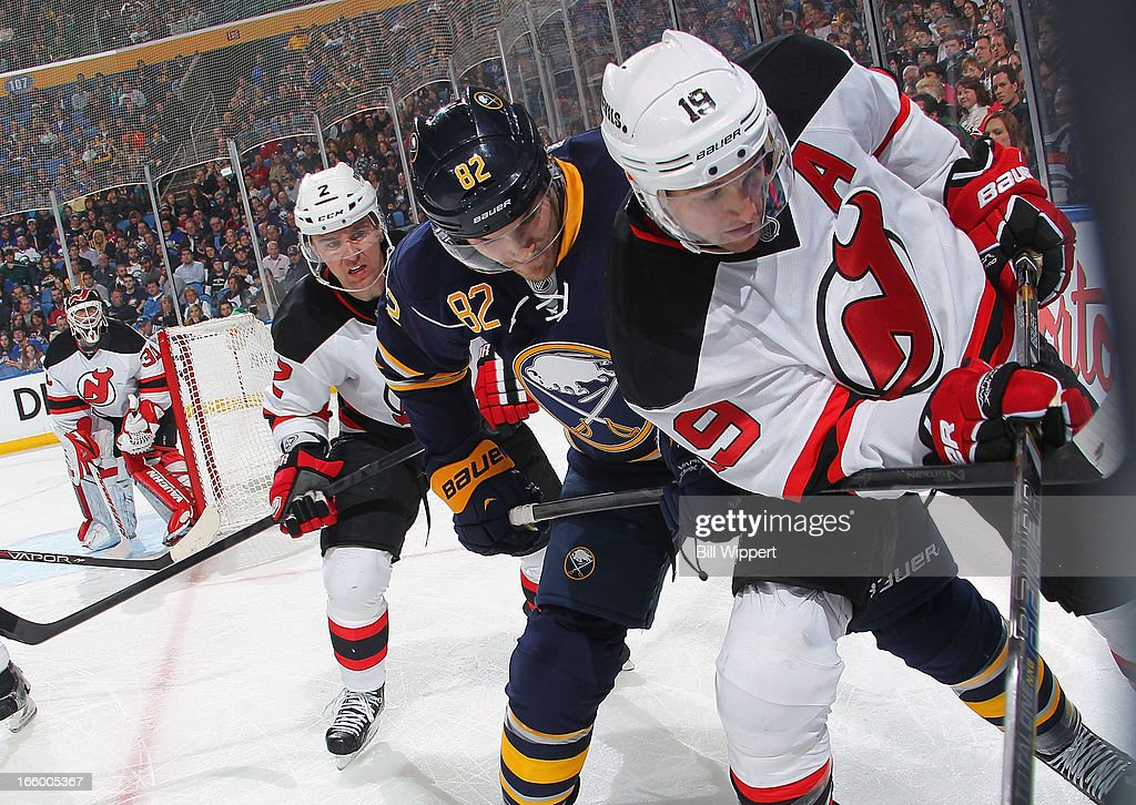 Marcus Foligno #82 of the Buffalo Sabres battles for the puck along the boards with Marek Zidlicky #2 and <a gi-track='captionPersonalityLinkClicked' href=/galleries/search?phrase=Travis+Zajac&family=editorial&specificpeople=864182 ng-click='$event.stopPropagation()'>Travis Zajac</a> #19 of the New Jersey Devils on April 7, 2013 at the First Niagara Center in Buffalo, New York. Buffalo defeated New Jersey, 3-2.