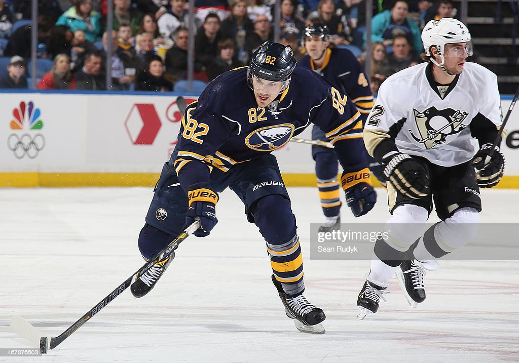Marcus Foligno #82 of the Buffalo Sabres carries the puck up ice against the Pittsburgh Penguins at First Niagara Center on February 5, 2014 in Buffalo, New York.